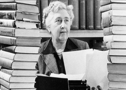 Agatha Christie Inside Library with Stacks of Books