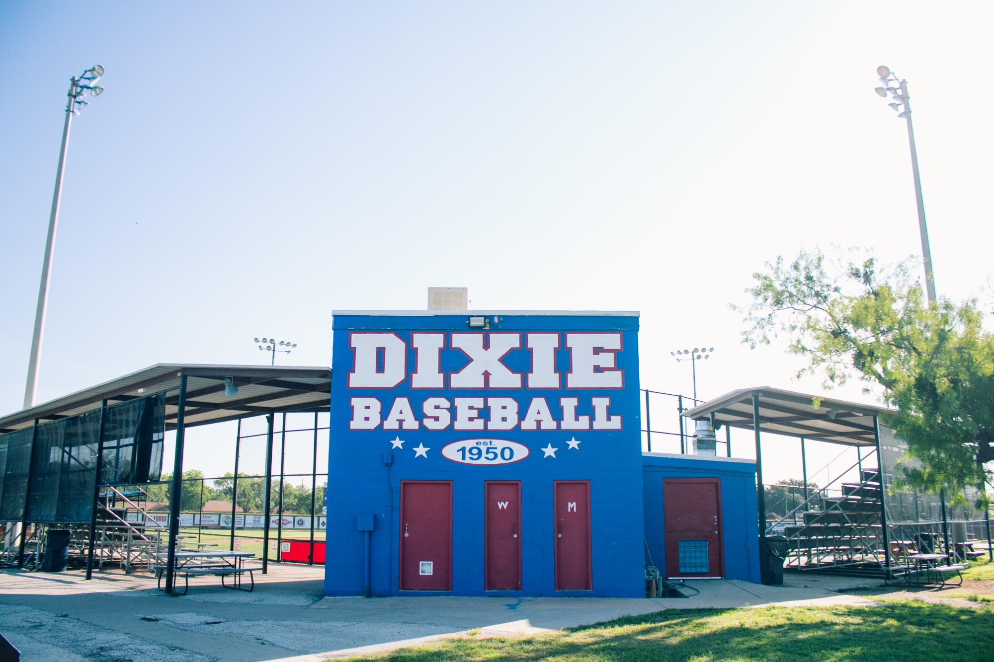 Blue Ballfield Building Reading Dixie Baseball on the Outside Wall