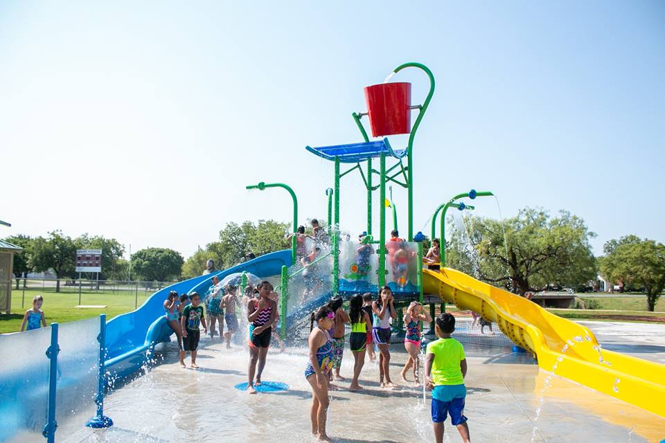 Kids playing together at Sears Park Splash Pad