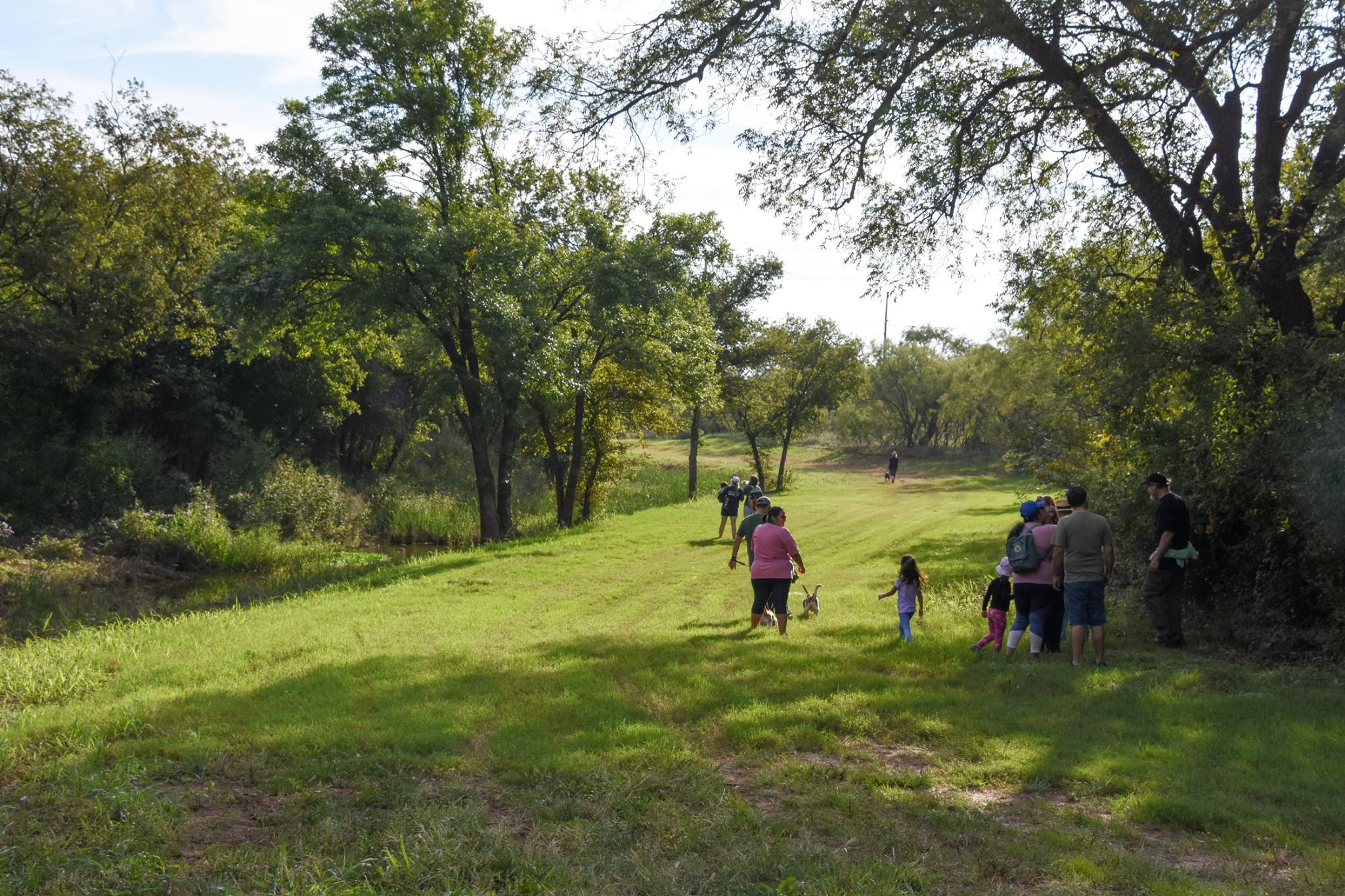 Abilene residents hike the Cedar Creek Waterway as part of the semi-annual Mayor's hike