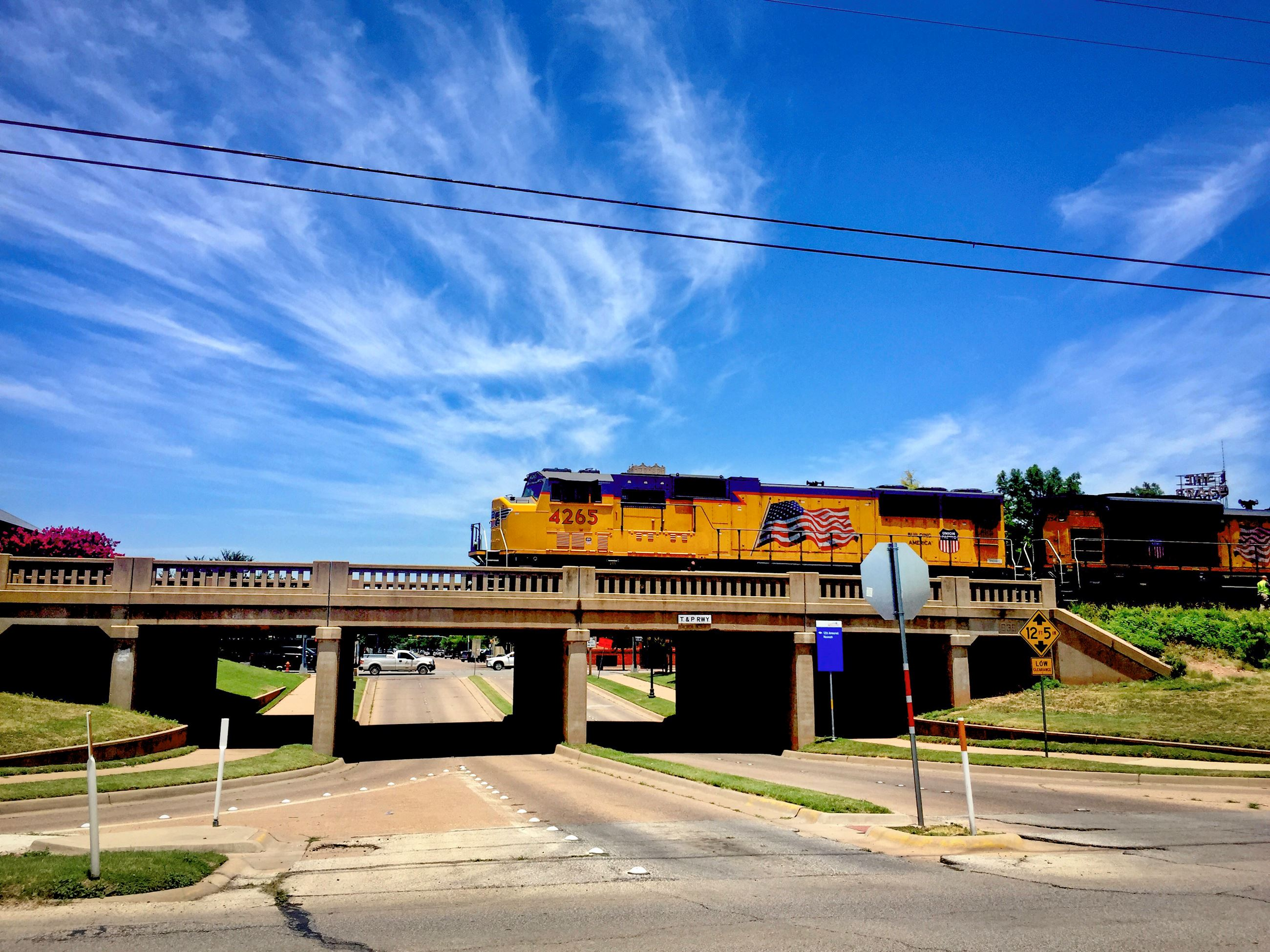 A Union Pacific train passes over T&P Lane near downtown Abilene