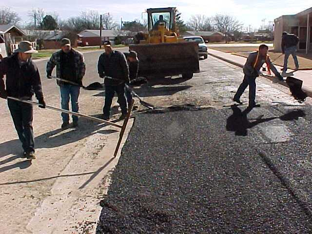 Workers Performing Asphalt Overlay