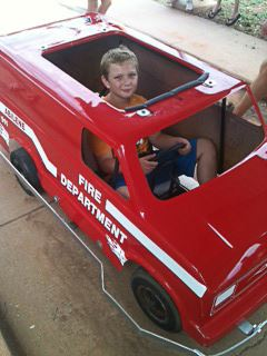 A child in a Safety City Firetruck