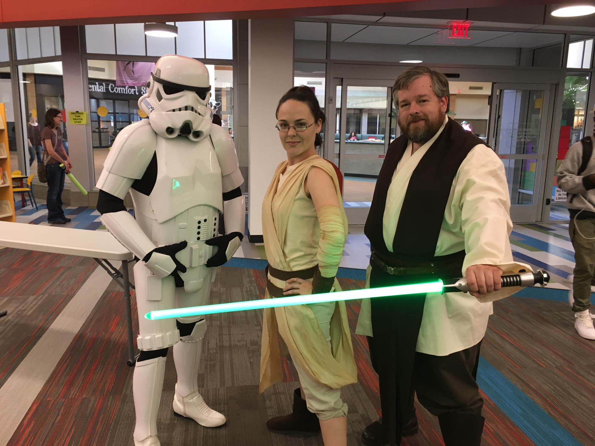 Lib-Con Attendees dressed as Rey, Luke Skywalker, and a Stormtrooper from Star Wars